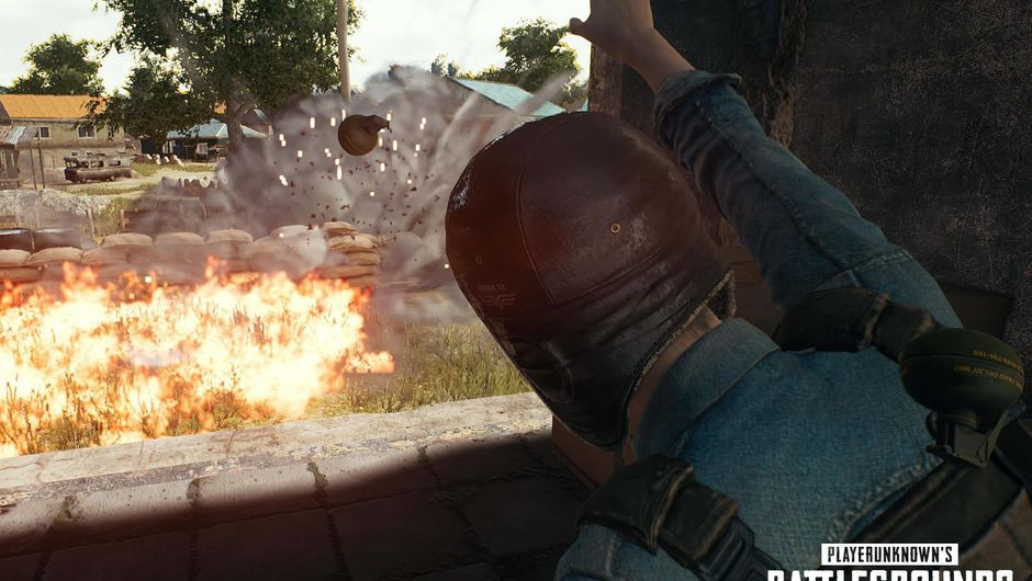 A man in aviator cap throwing grenades in PUBG's mode Dodgebomb