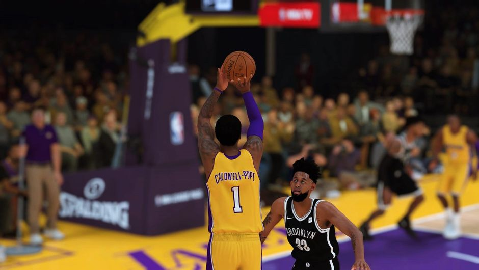 Kentavious Caldwell-Pope going for a jumper, wearing his home Lakers uniform