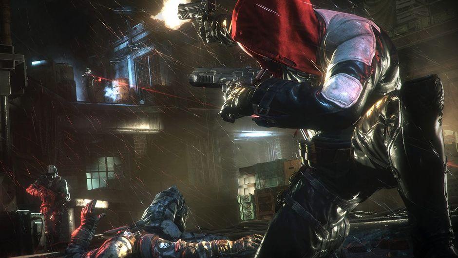 screenshot from batman arkham knight showing red hood firing a gun at opponents