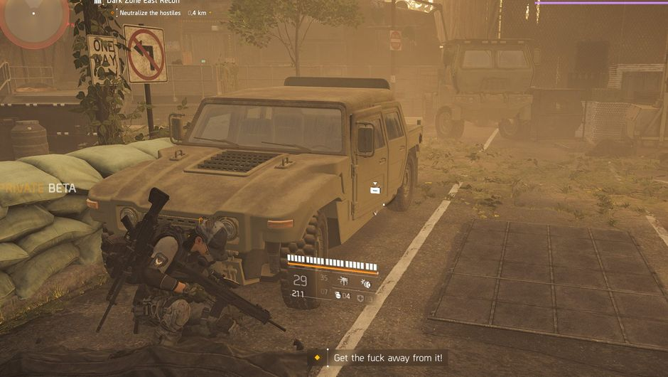 Picture of an agent hiding behind a Humvee in The Division 2