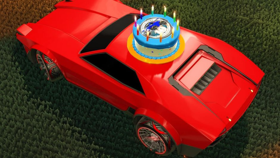 A red racing car from Rocket League with a birthday cake on top