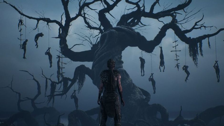 Screenshot from Hellblade: Senua's Sacrifice showing Senua in front of a tree where a pile of people were hanged.