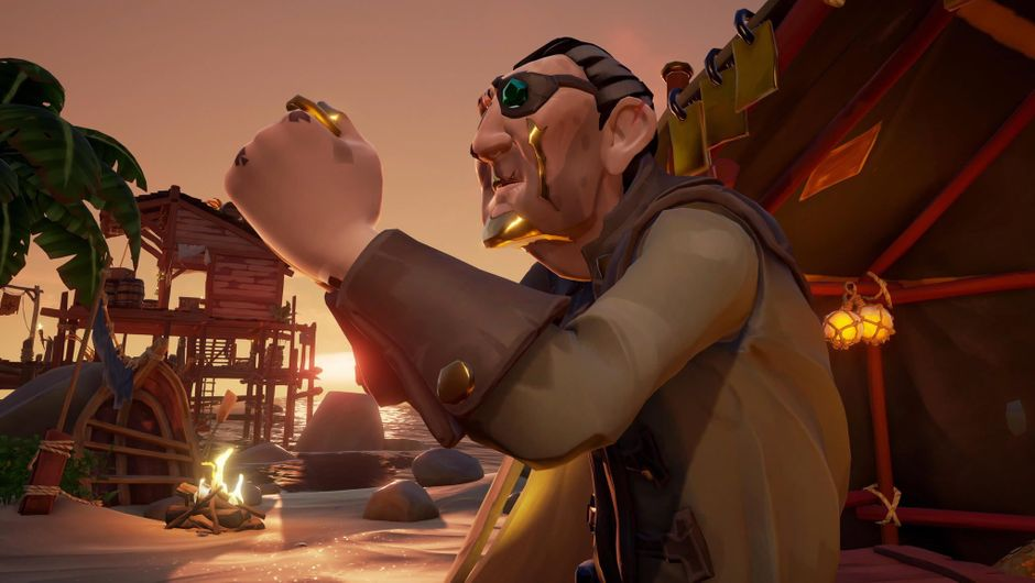A man with an eye patch holding a gold coin in the game Sea of Thieves