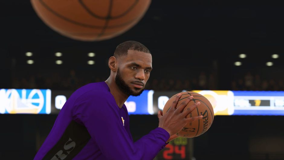 LeBron James holding a basketball in a Lakers pre-game uniform.
