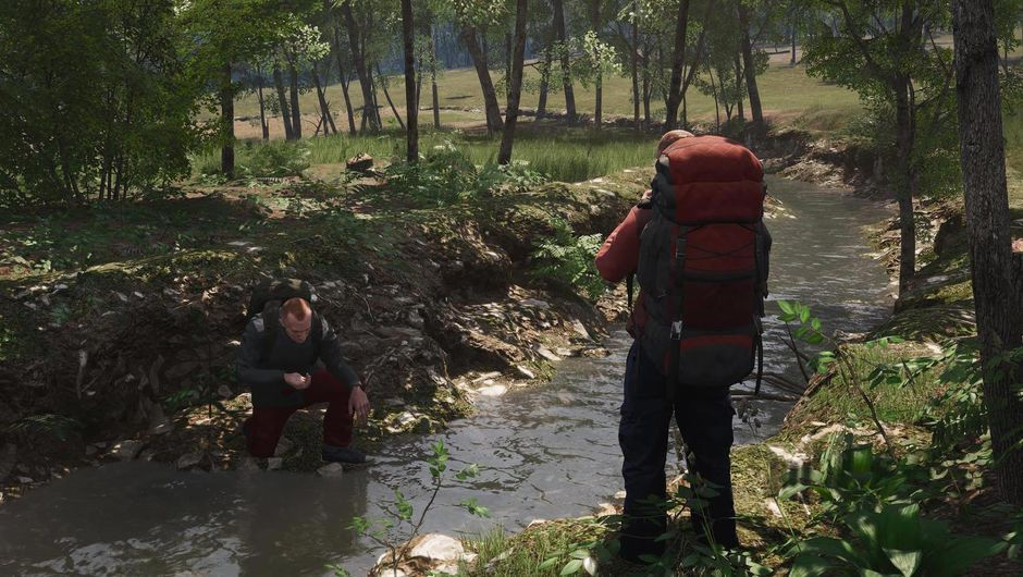 Two men with large backpacks standing next to a river in SCUM
