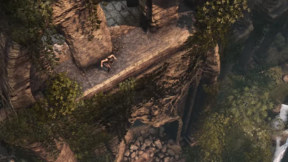 An aerial shot of Lara Croft jumping off of an ancient ruin
