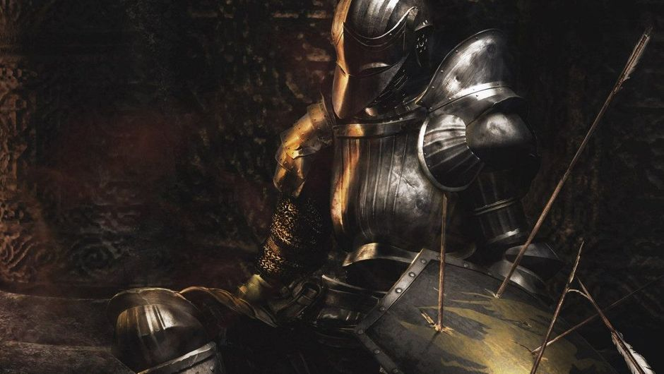 Demon's Souls promotional image showing a dead knight in shining armour.