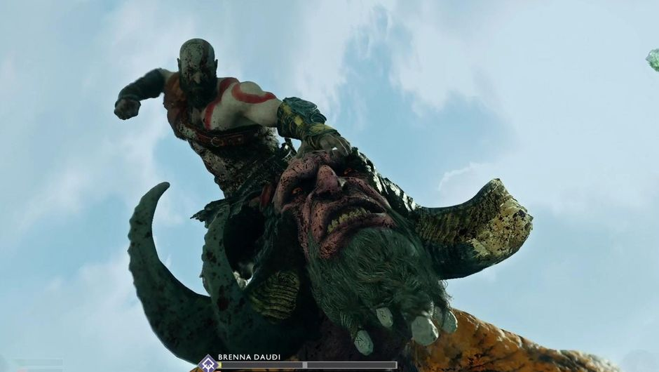 Kratos ending a fight with Brenna Daudi by performing his finisher.