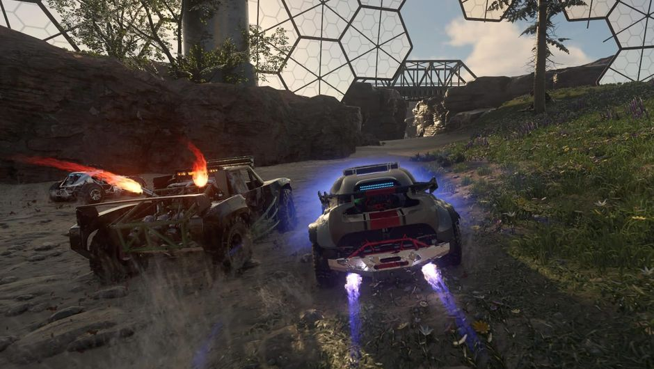 Two cars racing under a dome structure in racing game Onrush