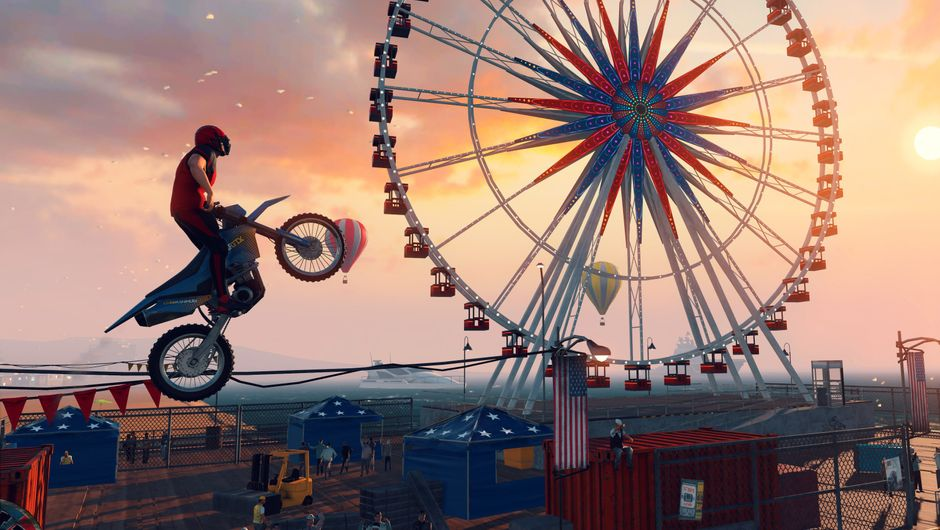 Picture of a guy on a dirt bike in the air next to a Ferris Wheel
