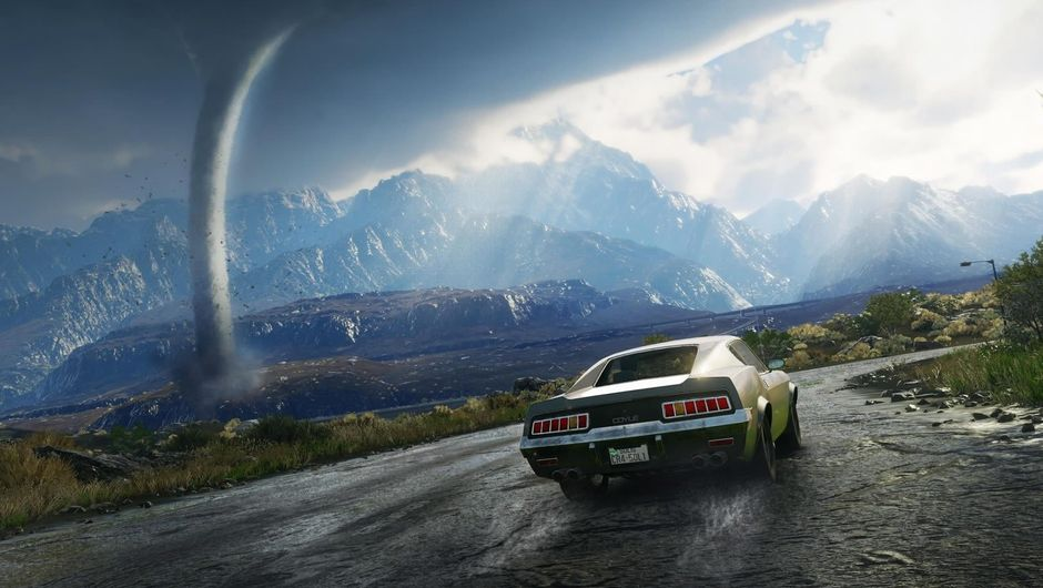 A car driving on a road with a tornado far away in Just Cause 4