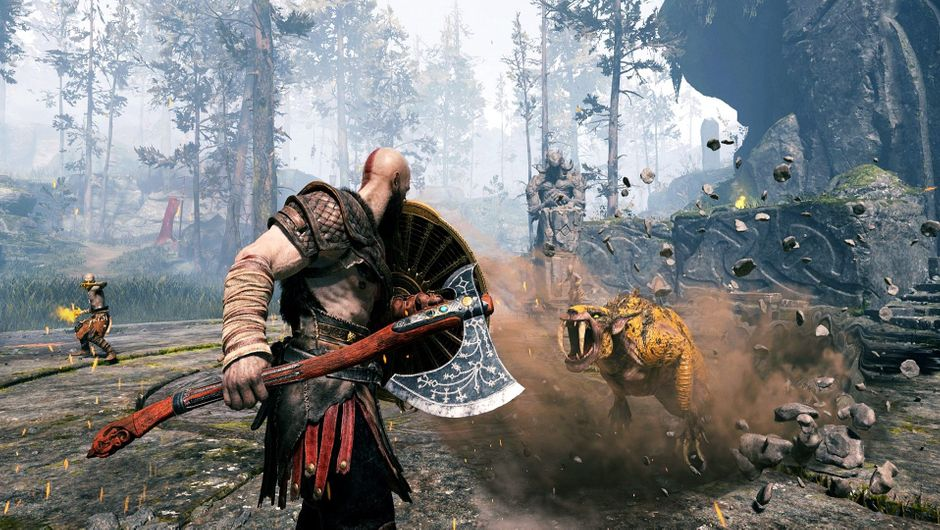 Kratos facing sabertooth beasts with his shield and axe.