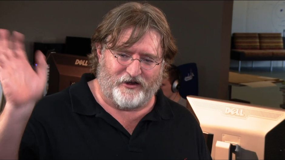 Picture of Gabe Newell at some event where he is waving around