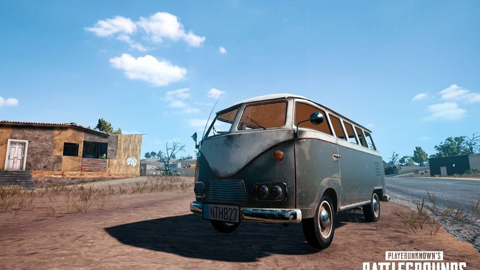 A blue Volkswagen Type 2 in a desert