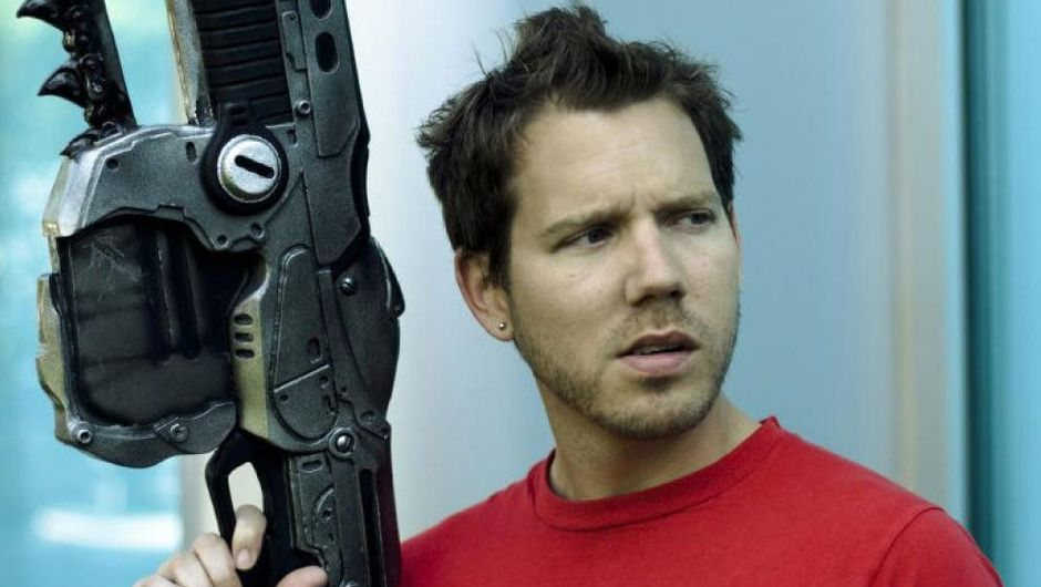 Cliff Bleszinski is looking in the distance with an Mk 2 Lancer Rifle replica.