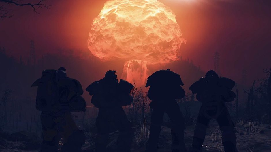 Picture of four people in Power Armour watching a nuclear explosion