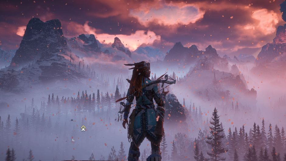 Screenshot from Horizon Zero Dawn showing Aloy watching a sunset that makes the landscape appear in orange and purple shades.