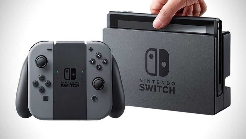 A hand removing the Switch from its dock. A Joy-Con controller grip.