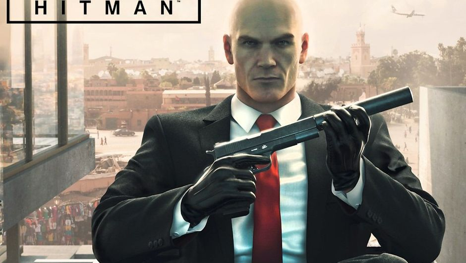 Agent 47 is sitting in a chair with his suppressed AMT Hardballer.