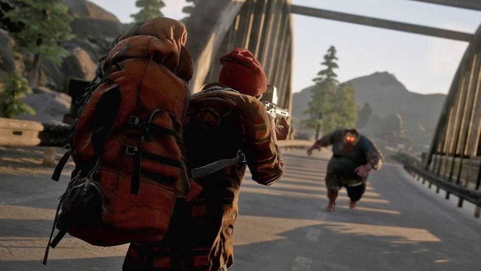 Screenshot from State of Decay 2 showing a Juggernaut zombie running at the player's character.