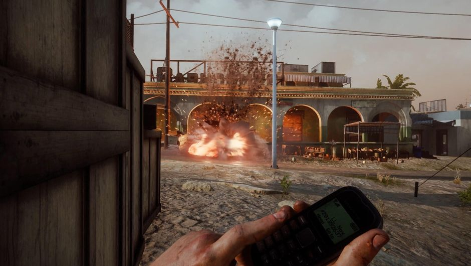 Screenshot from Insurgency: Sandstorm showing a player activating an IED with a cellphone.
