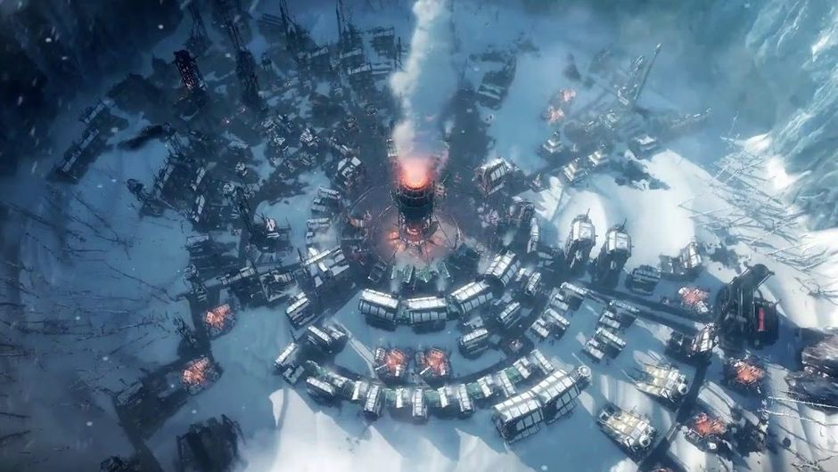 Frostpunk screenshot showing a city built around what seems to be a giant furnace.