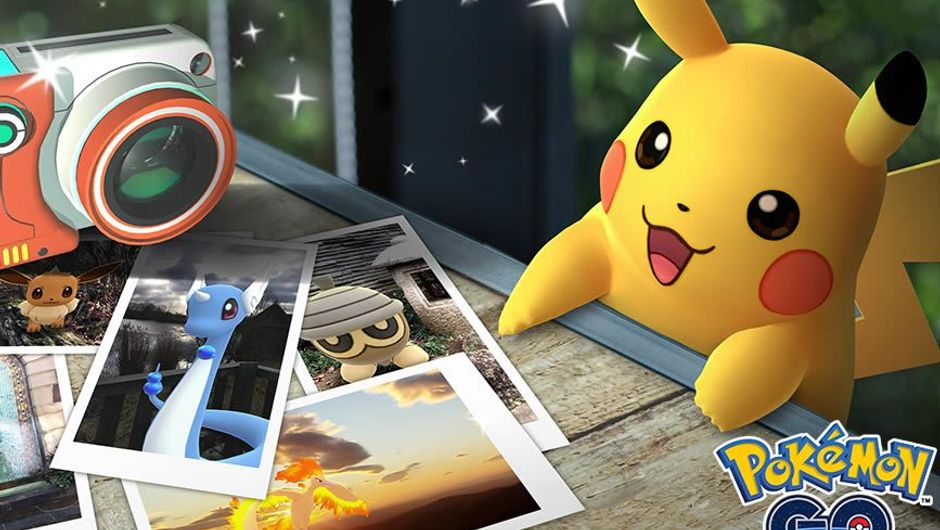 Pikachu behind a table filled with photos