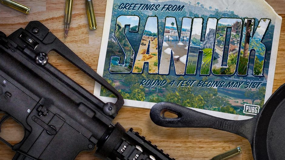Image of an AR 15 rifle on a table, next to a Sanhok postcard and a frying pan