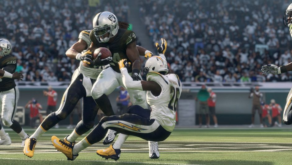 In-game screenshot of an Eagles player being tackled by his opponents.