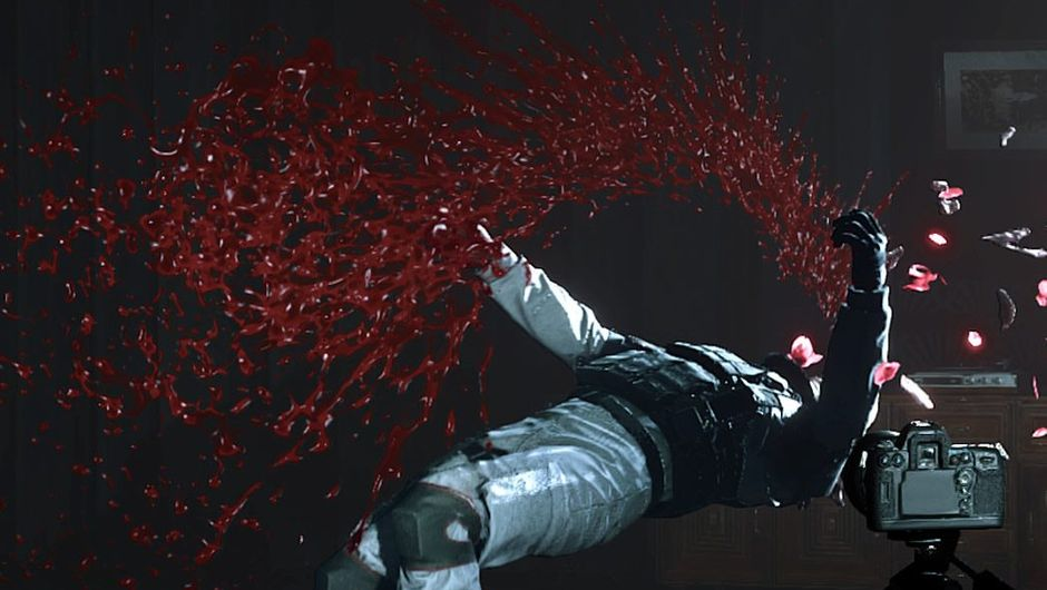 A person falling on his back, leaving behind a trail of blood