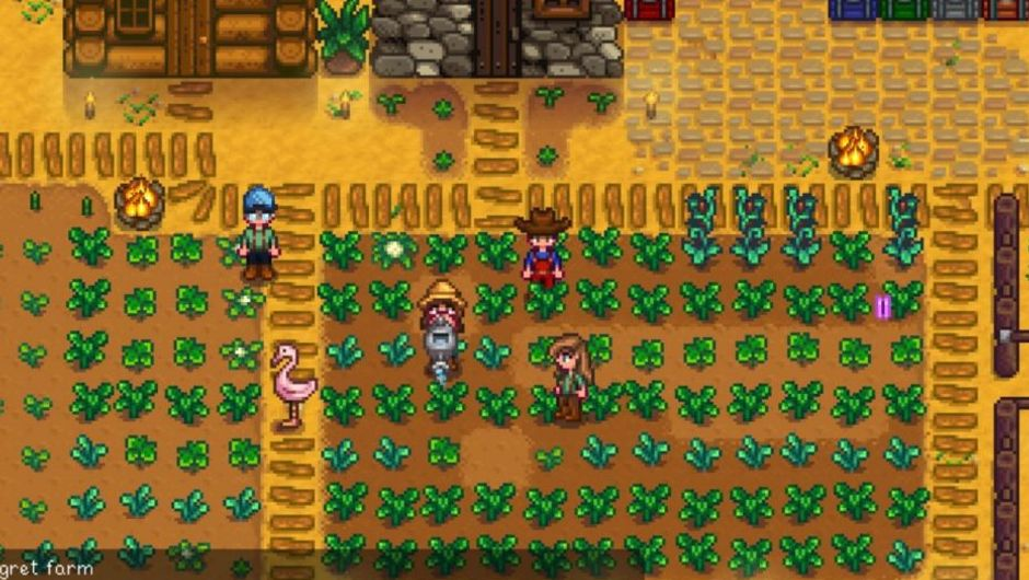 Pixelated people farming pixelated potatoes and tomatoes.