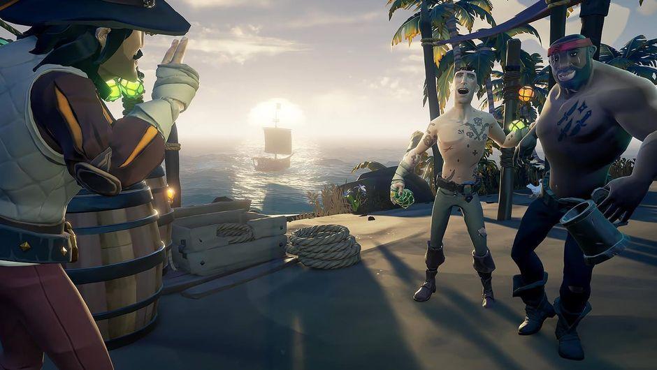 Three pirates standing around in Rare's game Sea of Thieves