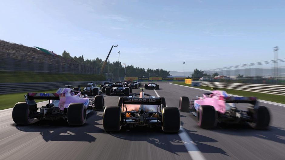 Several Formula One cars racing on a track