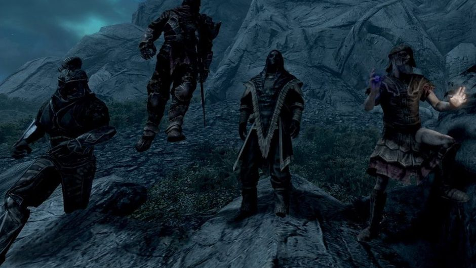 picture showing four characters standing on rocks