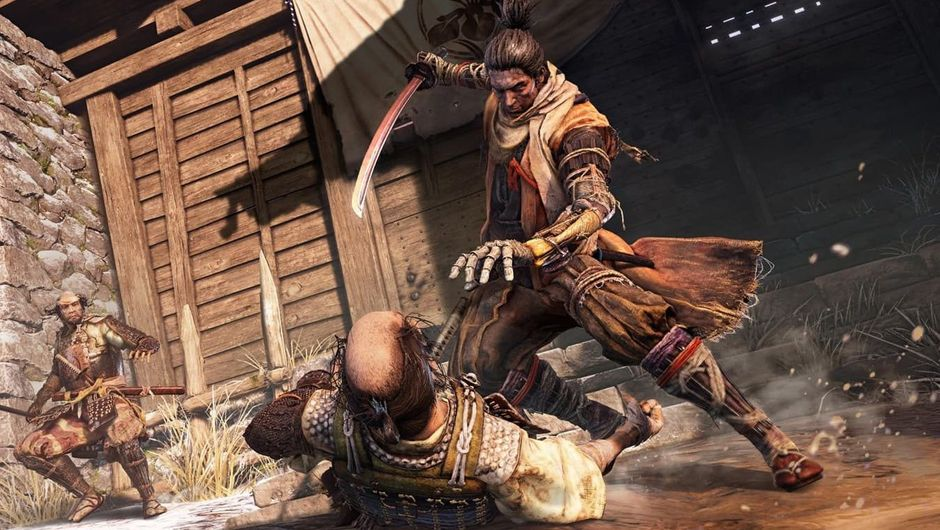 Sekiro is about to kill some dude who is laying on the ground