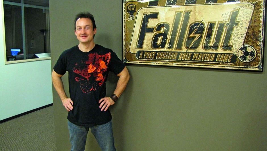 Picture of Chris Avellone next to Fallout promotional material