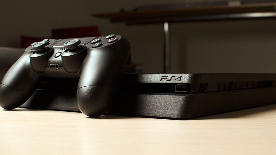 Picture of a PlayStation 4 sitting on a table or something