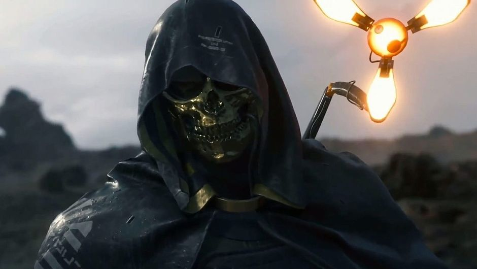 death stranding screenshot showing a man wearing a golden mask and black robe