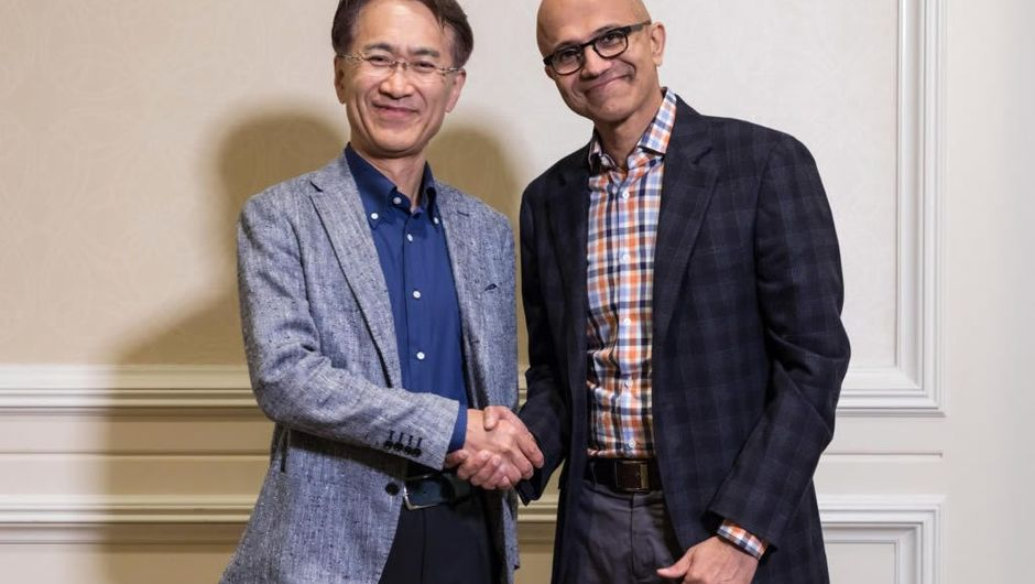 Sony and Microsoft CEOs shaking hands