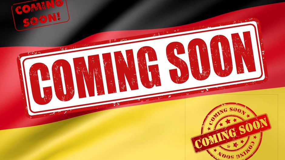 German flag with three Coming Soon signs on it